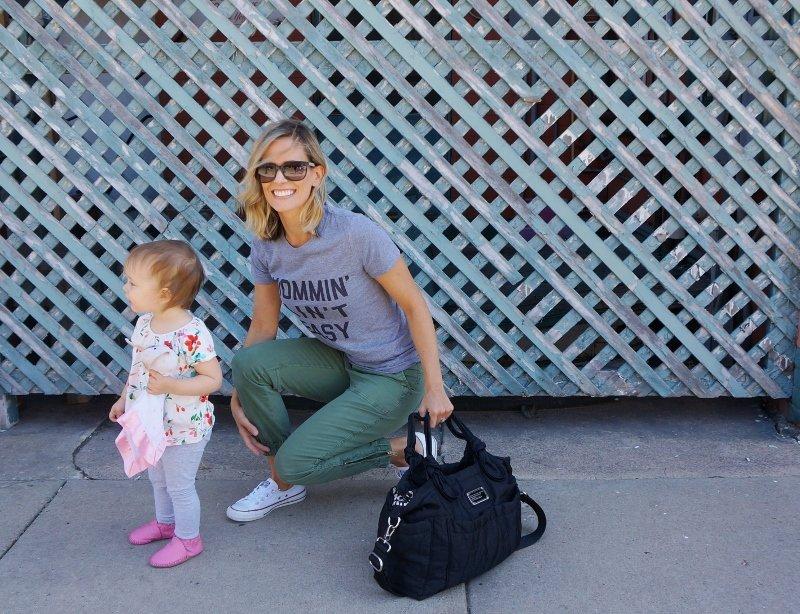 #momlife: graphic tee, olive pants, tote, sunglasses, and sneakers