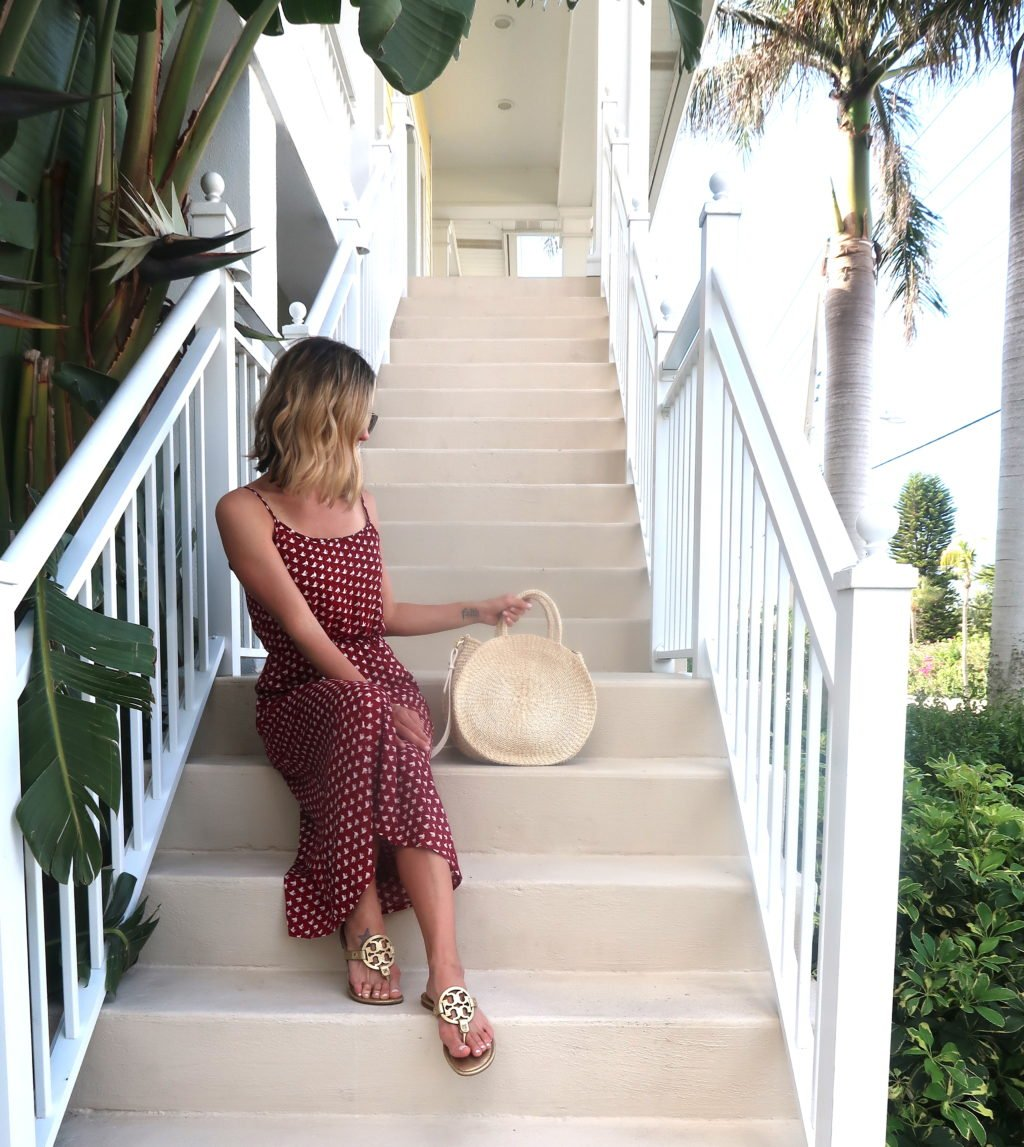 Beach vacation style, maxi dress, straw tote, sandals