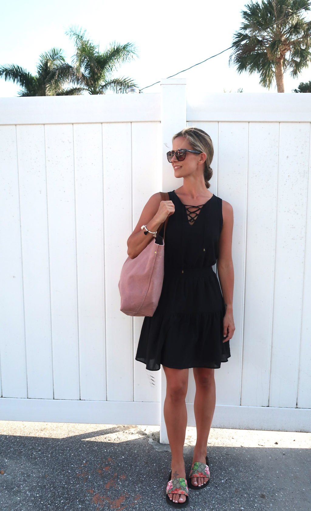 Beach vacation style, black dress, oink tote, sandals