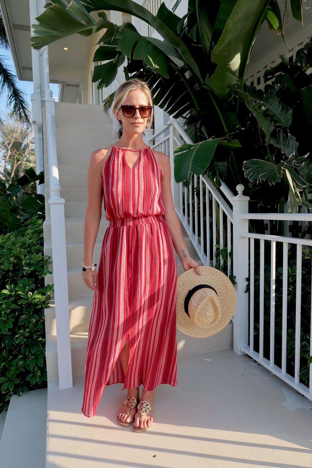Beach vacation style, striped maxi dress, straw hat, sandals