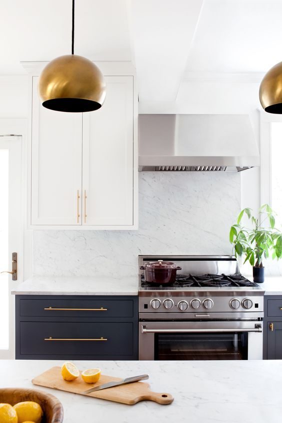 Kitchen remodel inspiration, white and black cabinets with gold accents