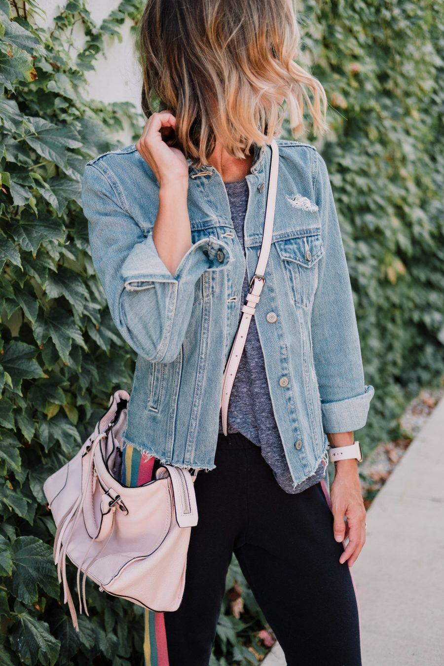 Wildfox sweatpants, tee, denim jacket, New Balance sneakers, cross body bag