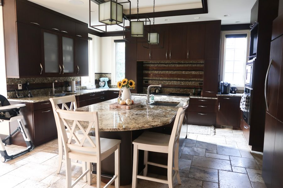 Our current kitchen, dark wood cabinets and granite countertops