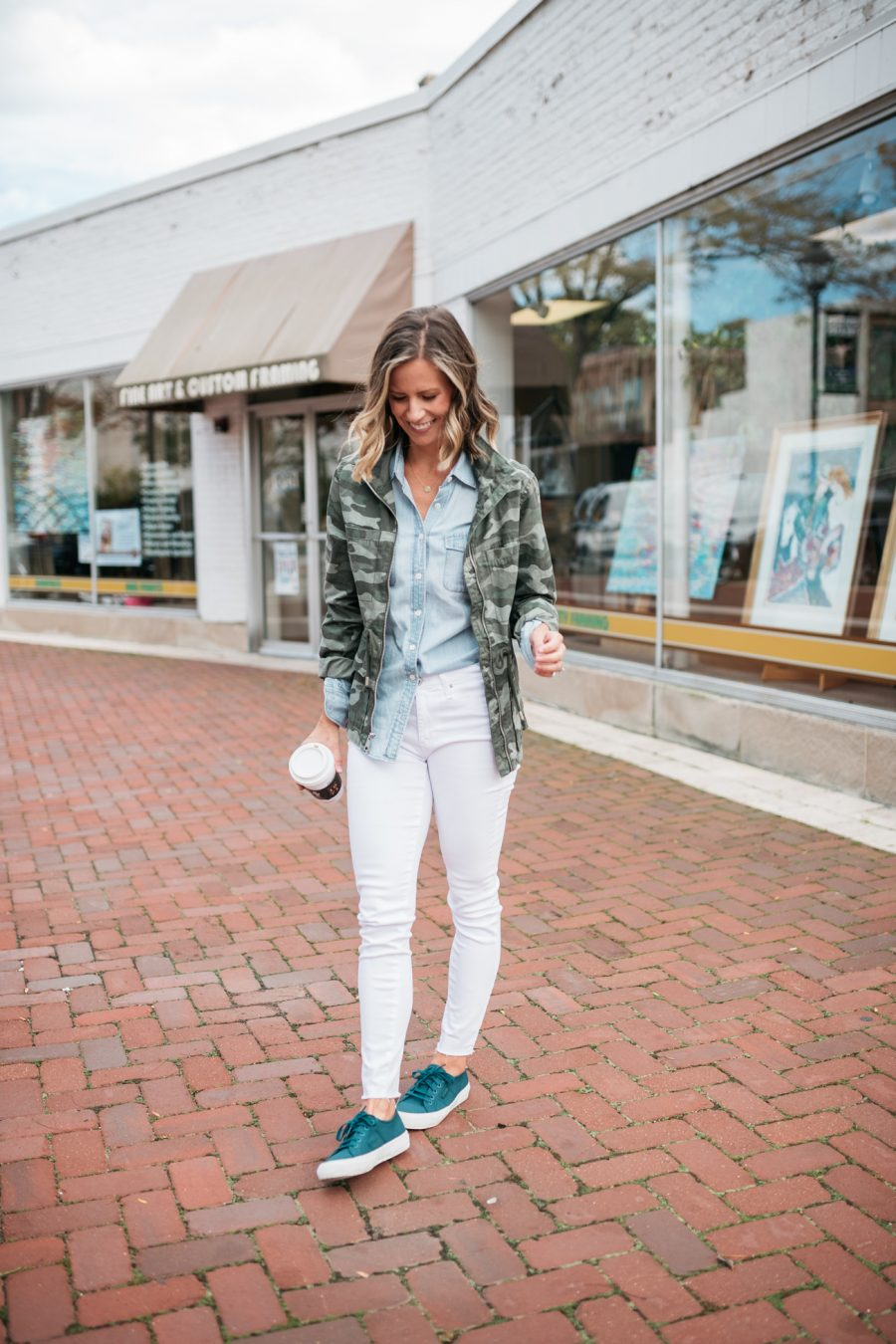 White denim for fall, chambray shirt, camo jacket, and sneakers