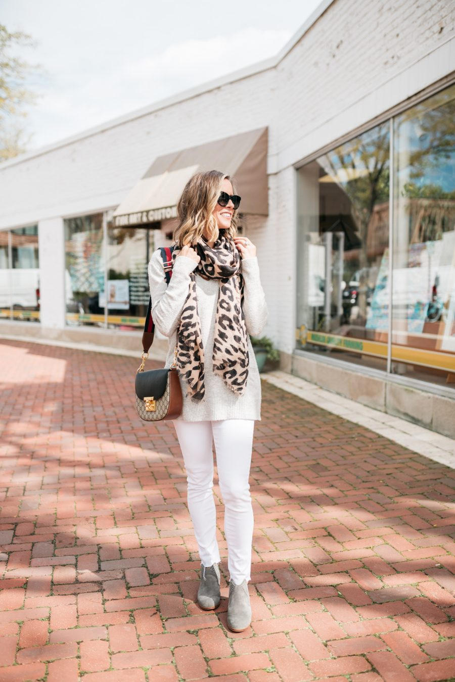 White denim for fall, grey sweater, leopard scarf, cross body bag, booties