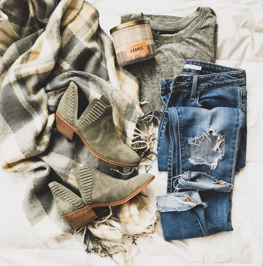Cape, tee, jeans, and booties