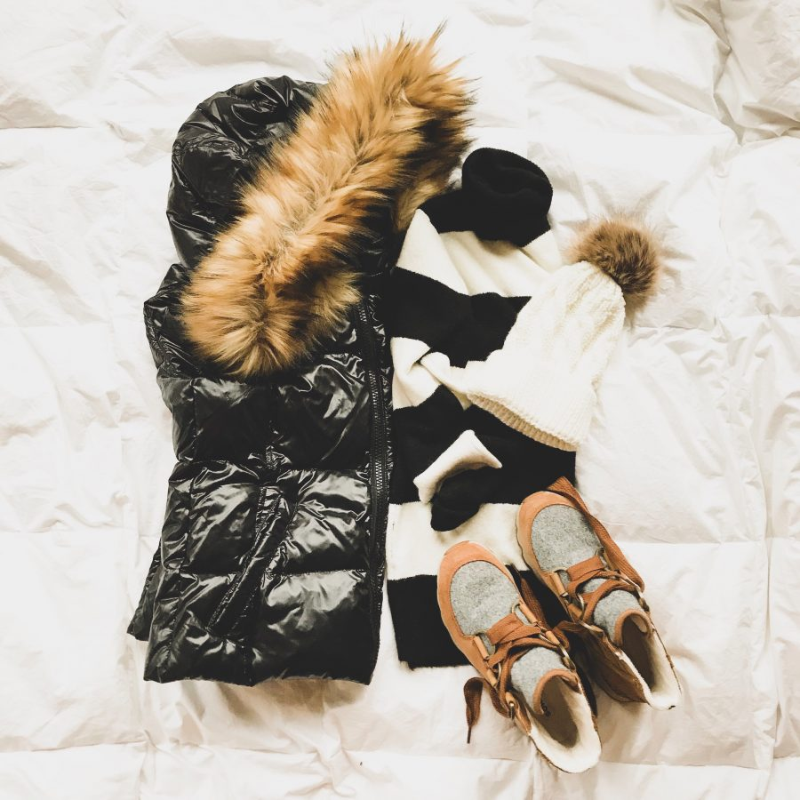 Puffer vest, striped turtleneck, beanie, and boots