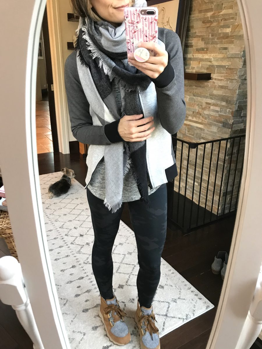 Scarf, tee, moto jacket, leggings, and boots