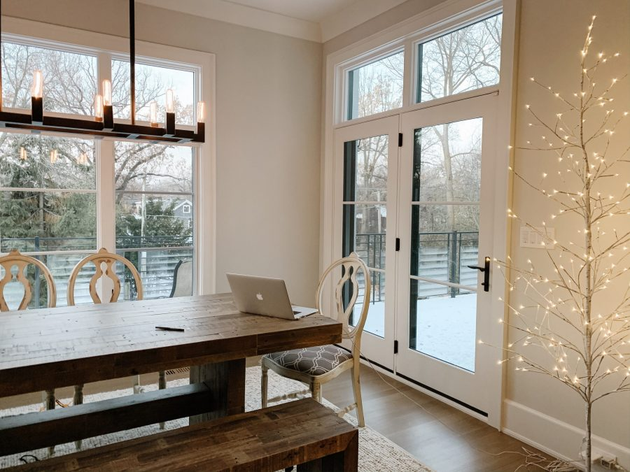 Home finds: dining room table, wood bench, rug, lighted birch tree