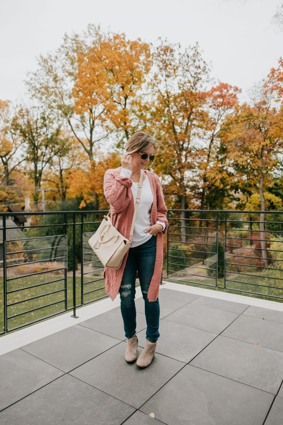 Thanksgiving outfit ideas--jeans, tee shit, cardigan, and booties