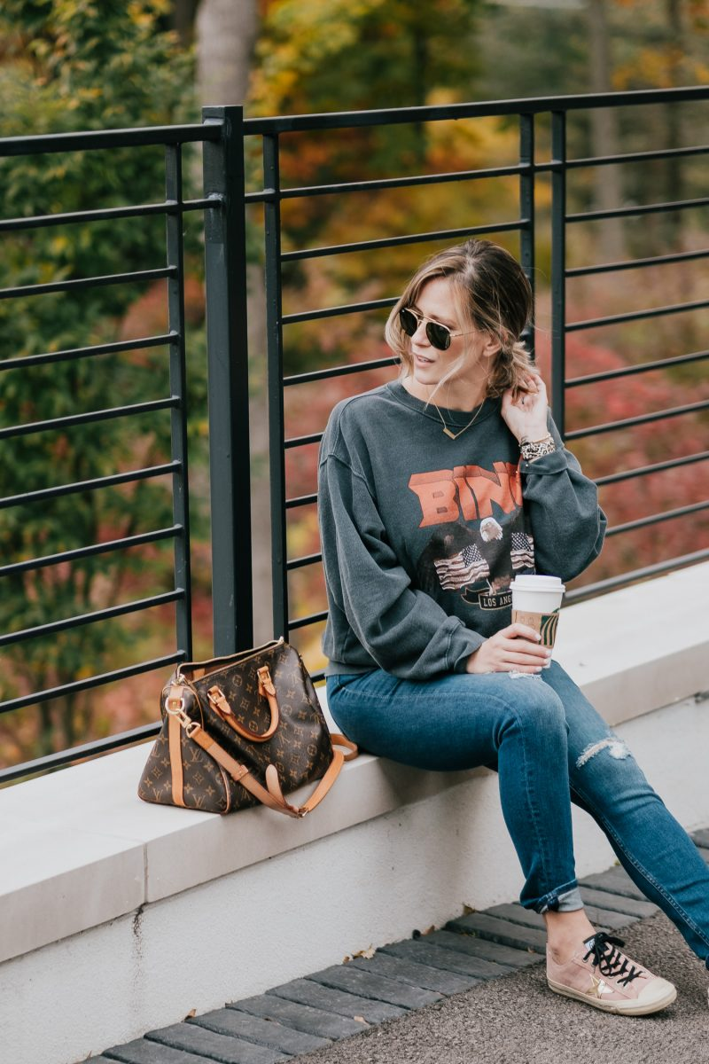 Postpartum casual outfit: sweatshirt, jeans, and sneakers