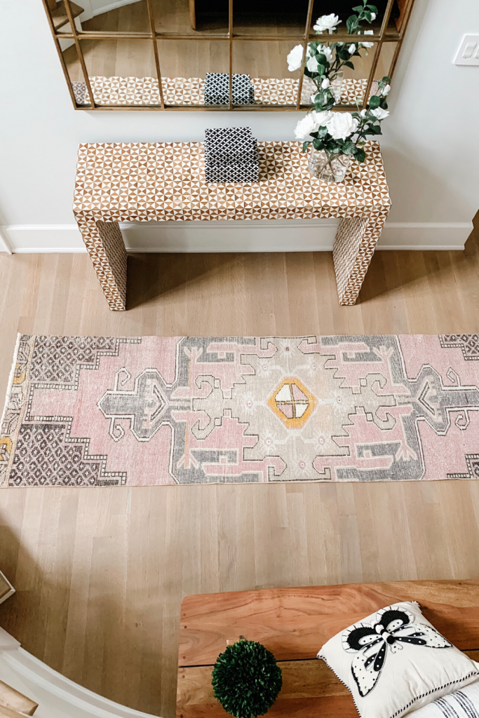 I found the most fabulous vintage rug on Etsy that compliments our entryway perfectly, I'm sharing the details along with some other decor.