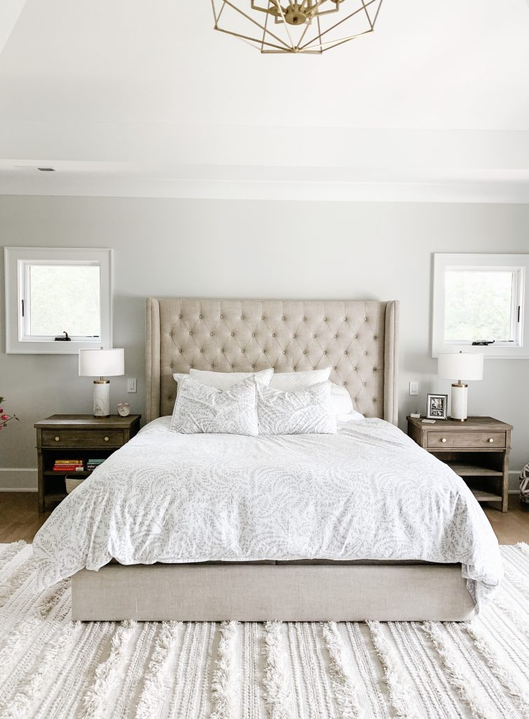 I'm sharing our cozy and neutral master bedroom complete with new curtains, comfy bedding, a floor length mirror, and the Samsung tv frame.