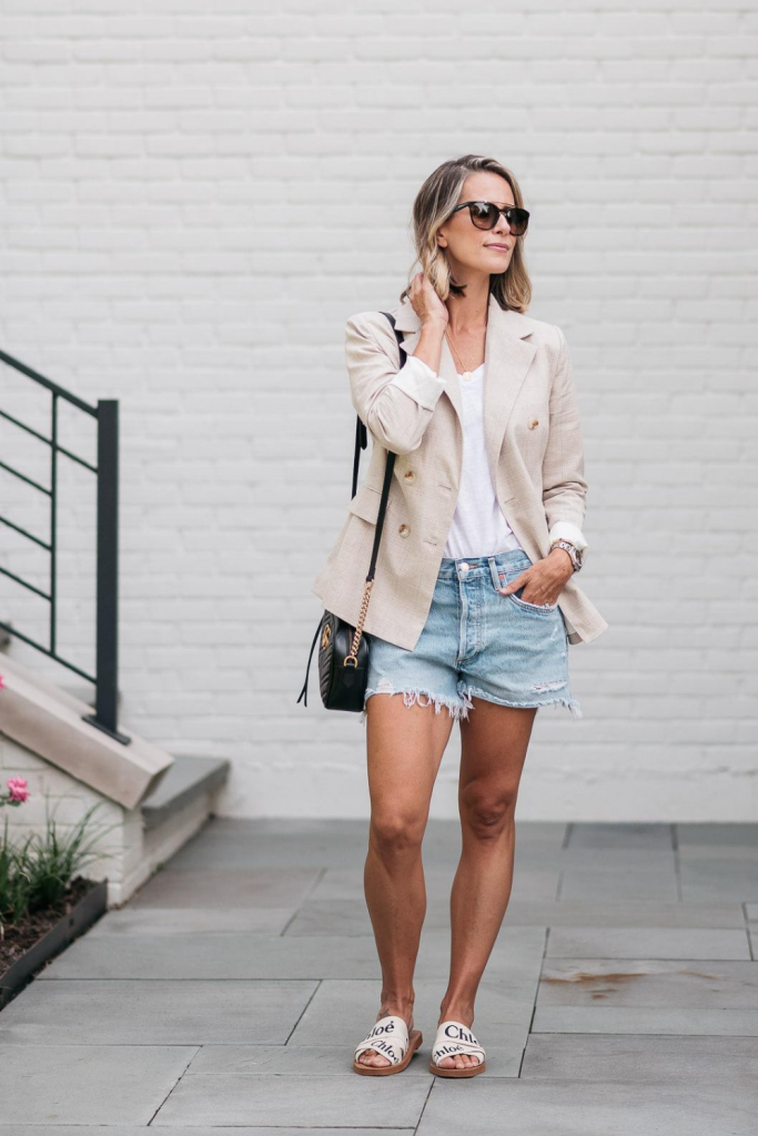 I'm pairing a chic boyfriend blazer with a pair of cut off denim shorts for the perfect outfit to transition from summer to fall.