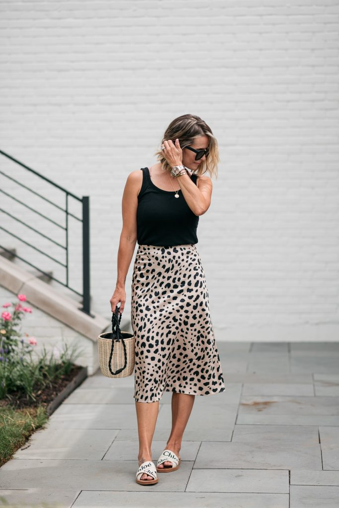I'm sharing a classic leopard slip skirt and how I'm transitioning it from summer to fall with a classic tank, denim jacket, and accessories.