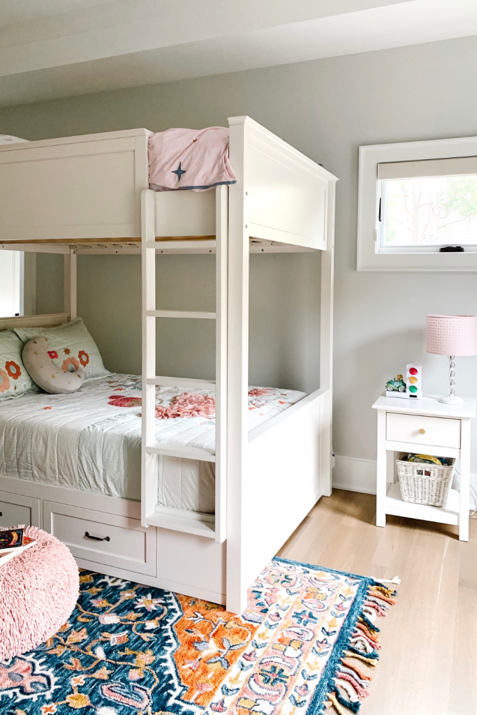 Transition to a big girl bedroom with bunkbeds, vibrant pops of color, and a cozy reading area.