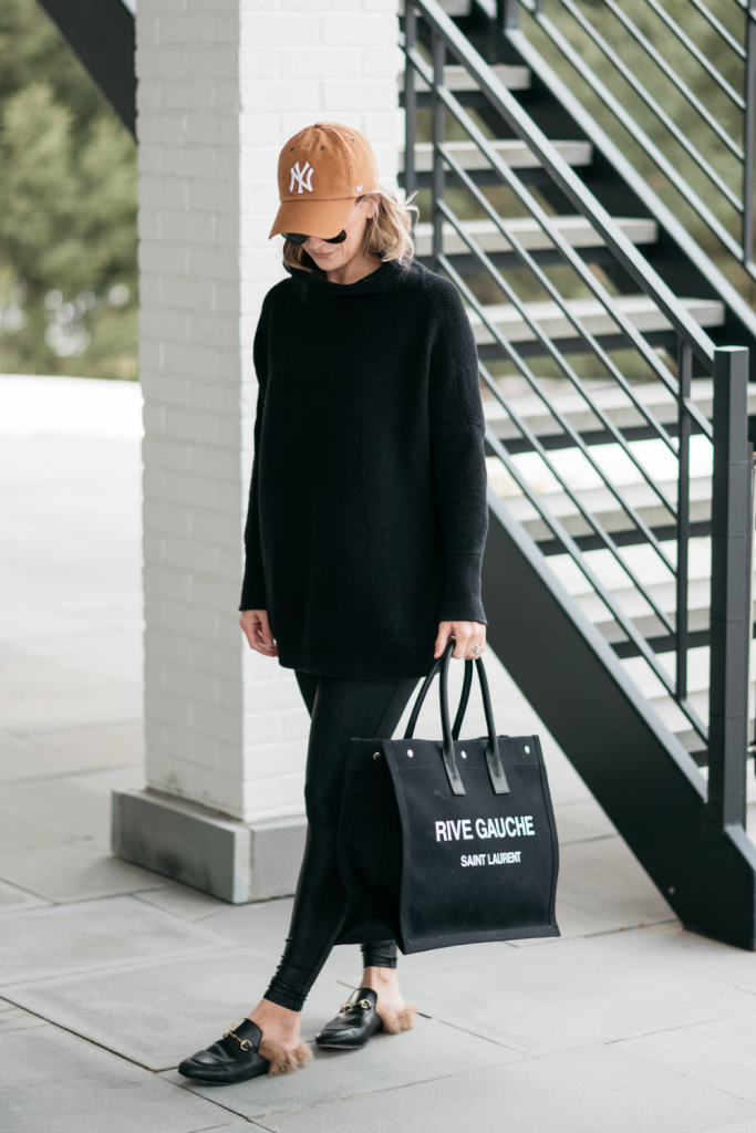 How to style a cozy black Free People tunic with black faux leather Spanx leggings and mules.
