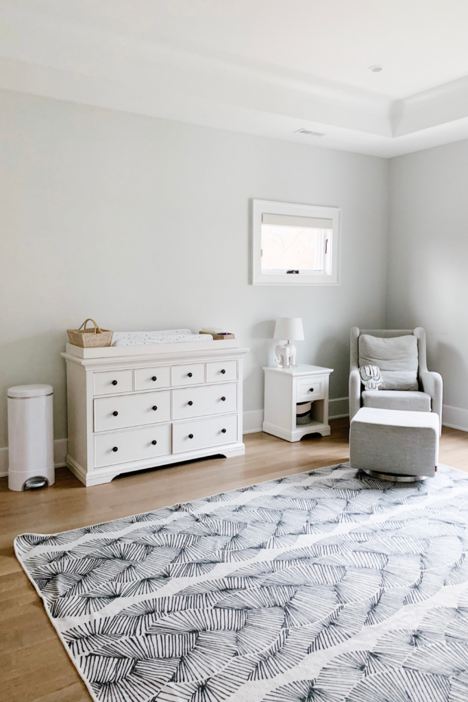 Revealing Baby Gray's nursery featuring a printed accent wall to pop against the minimalistic and sleek furniture and decor.