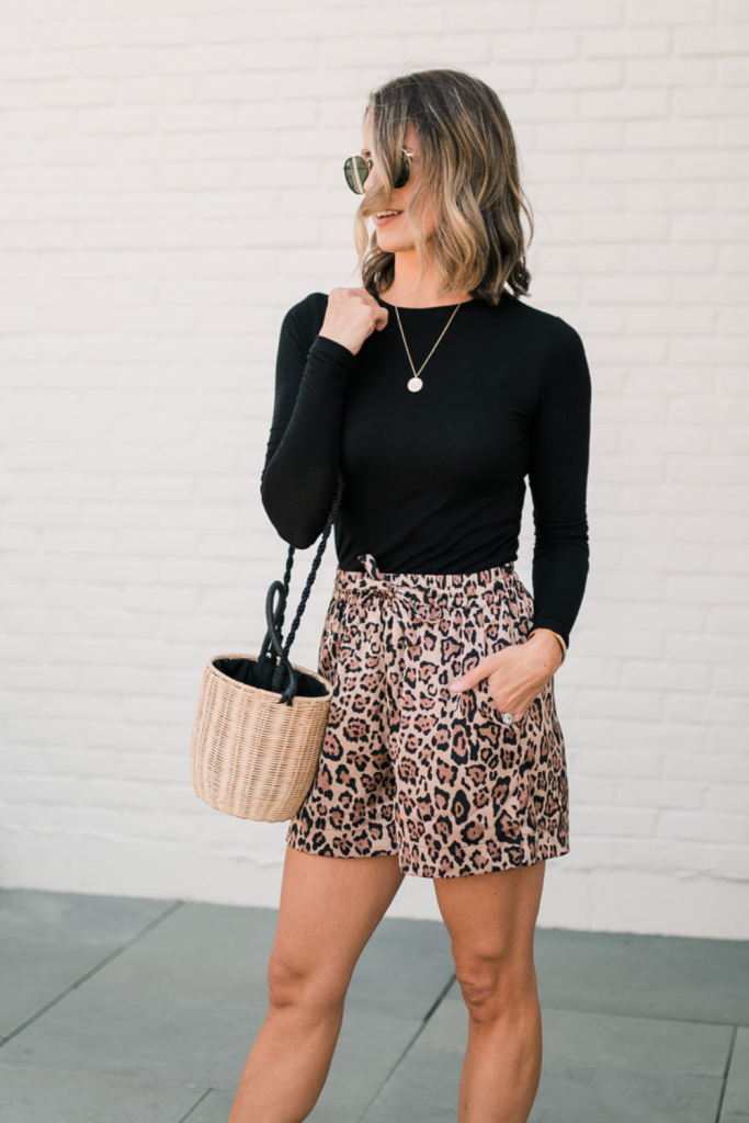 Long sleeve black tee, bucket bag, leopard shorts, sandals