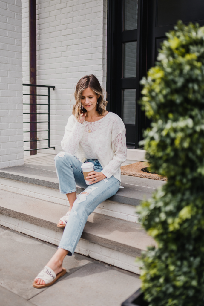 Spring outfit: white sweater, jeans, necklace, and sandals